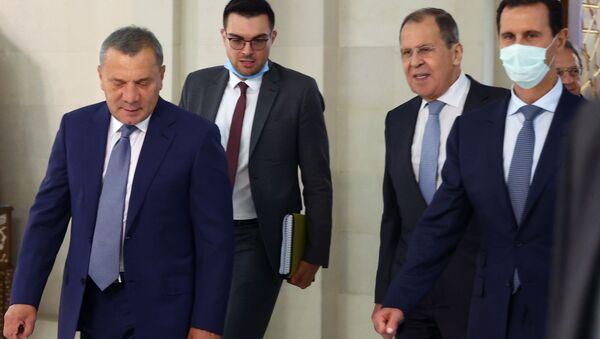 Ruská delegace za účasti ruského vicepremiéra Jurije Borisova a ministra zahraničí Sergeje Lavrova na návštěvěSýrie. - Sputnik Česká republika