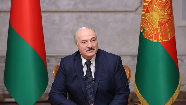 Běloruský prezident během rozhovoru s ruskými novináři - Sputnik Česká republika