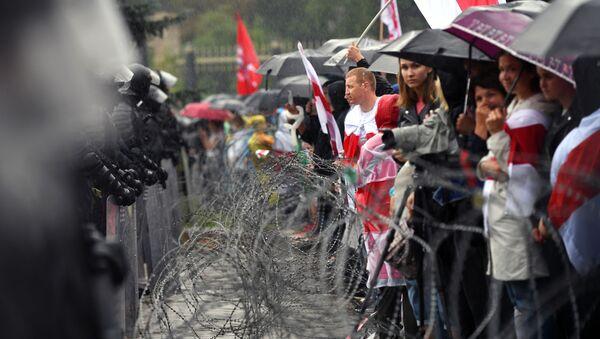 Protestní akce v Minsku proti prezidentovi Alexandru Lukašenkovi - Sputnik Česká republika