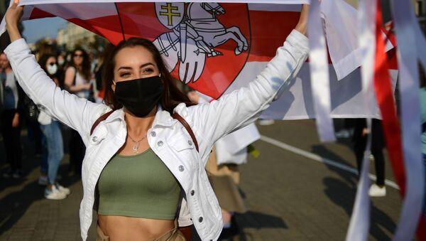 Účastnice protestní akce v Minsku. Ilustrační foto - Sputnik Česká republika