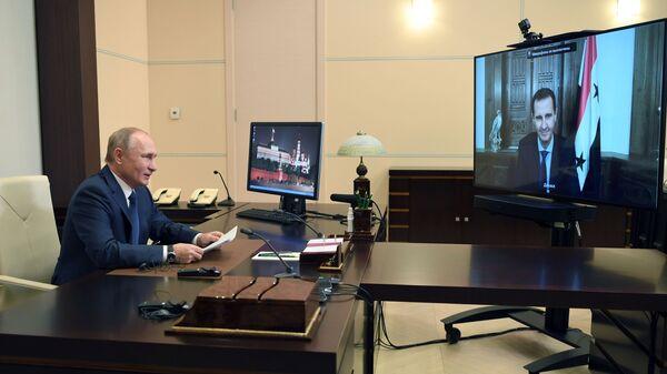 Vladimir Putin během videokonference s Bašárem Asadem  - Sputnik Česká republika