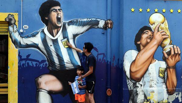 Lidé truchlí kvůli smrti Diegy Maradona - Sputnik Česká republika