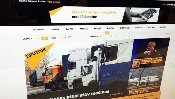 Stránka Sputniku v lotyštině - Sputnik Česká republika