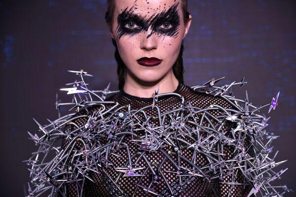 Model v oblečení vyrobeném z recyklovaných materiálů na módní přehlídce v Tchaj-peji, Tchaj-wan - Sputnik Česká republika
