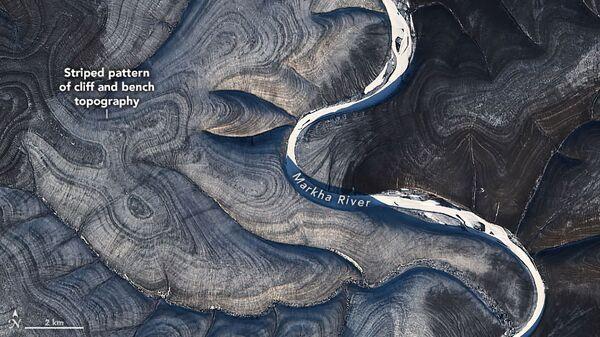 NASA je ohromena záhadnými pruhy, které na satelitních obrázcích tvoří ruskou arktickou Sibiř - Sputnik Česká republika