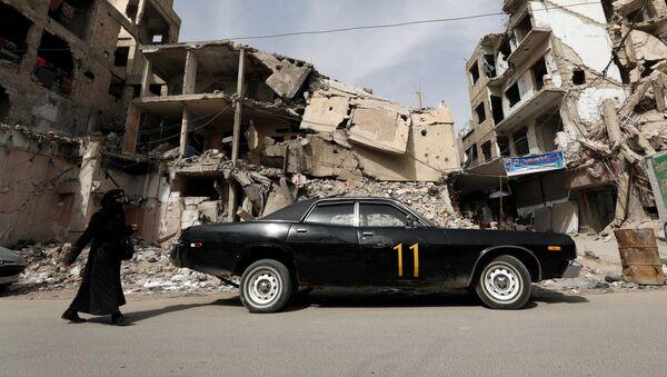 Život v troskách: Syrské město Dúmá po uplynutí tří let od chemického útoku - Sputnik Česká republika
