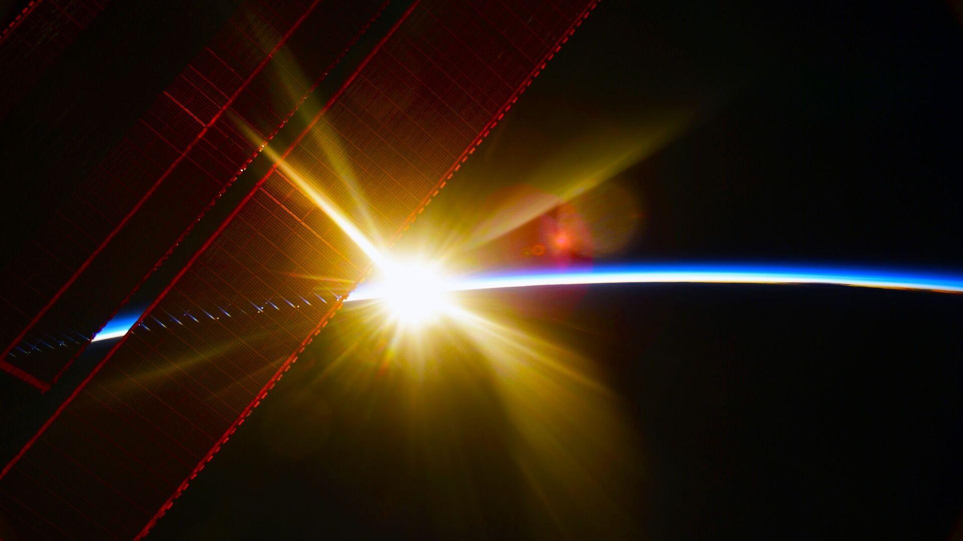 Pohled z ISS na úsvit nad Zemí - Sputnik Česká republika, 1920, 03.04.2021