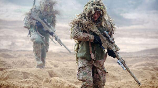 Vojáci NATO na vojenském cvičení v Lotyšsku - Sputnik Česká republika