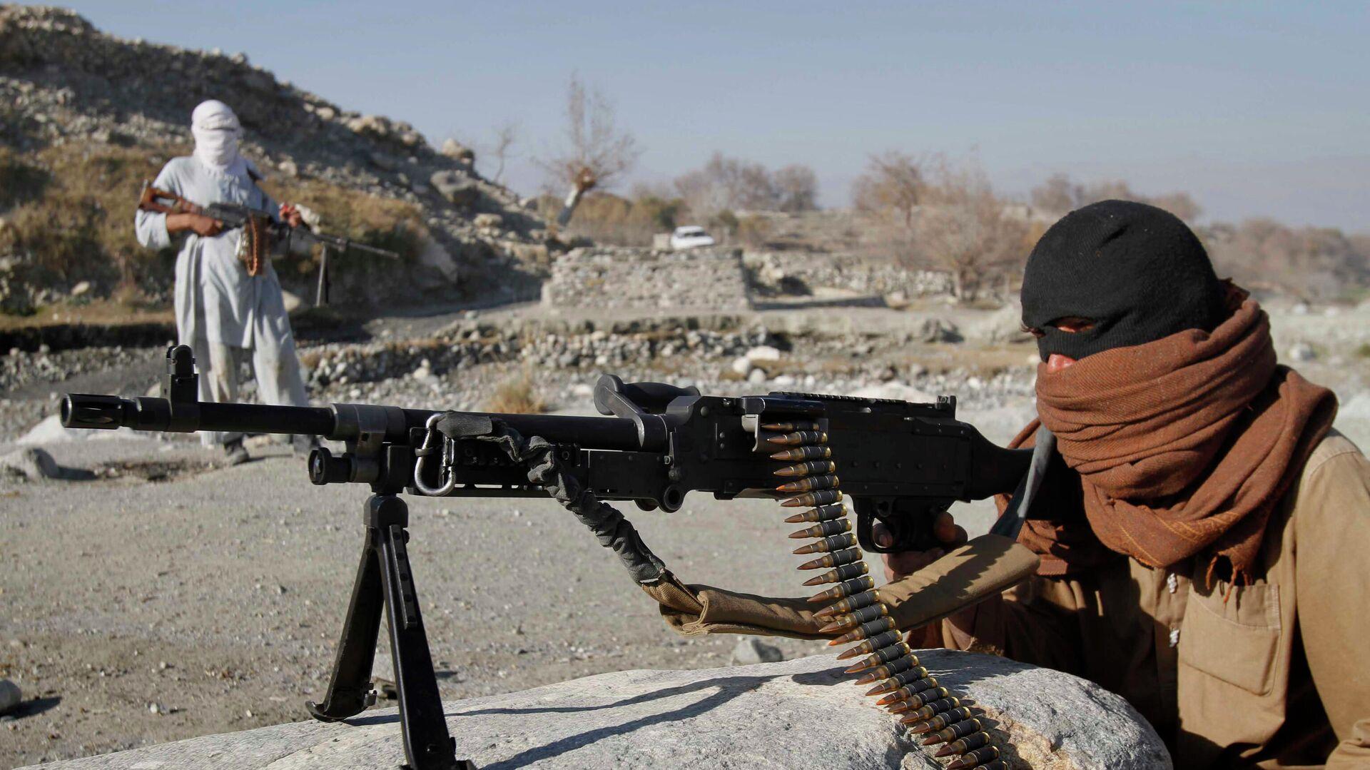Bojovníci radikálního hnutí Tálibán v Afghánistánu - Sputnik Česká republika, 1920, 11.07.2021