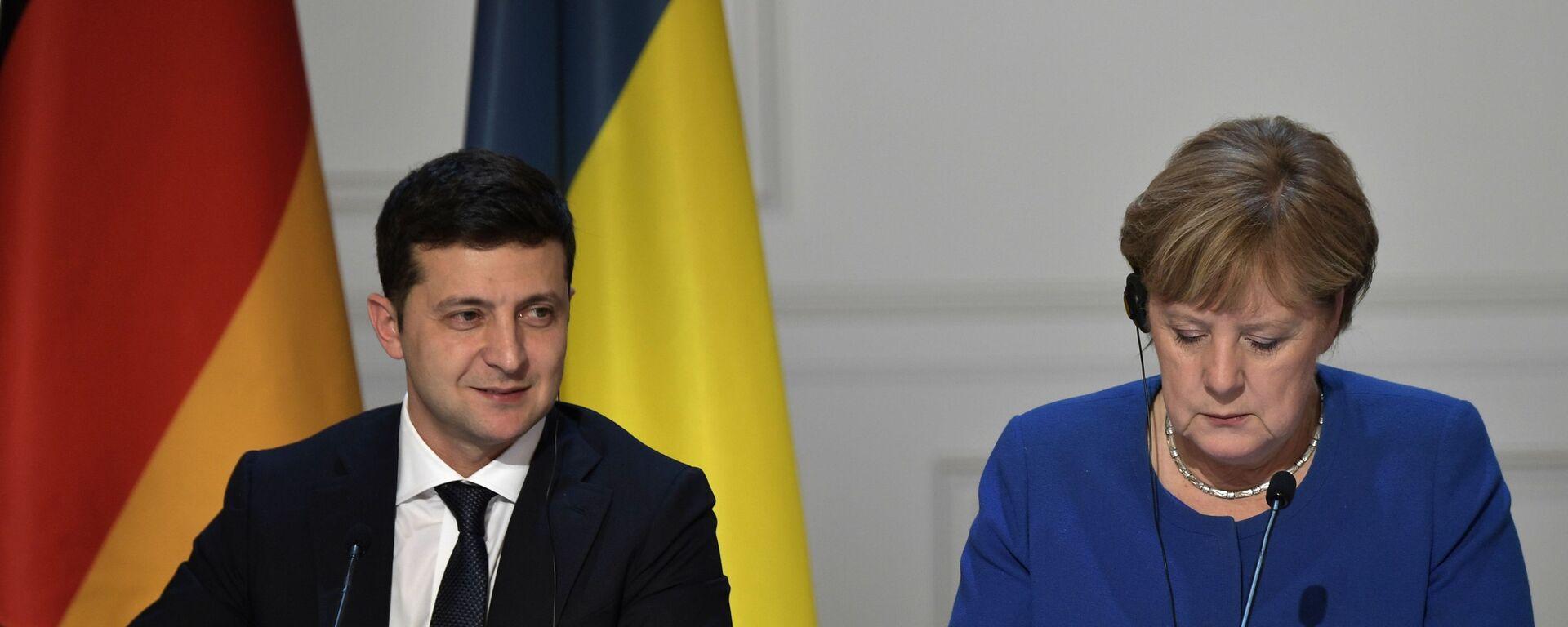 Ukrajinský prezident Volodymyr Zelenskyj a německá kancléřka Angela Merkelová - Sputnik Česká republika, 1920, 22.08.2021