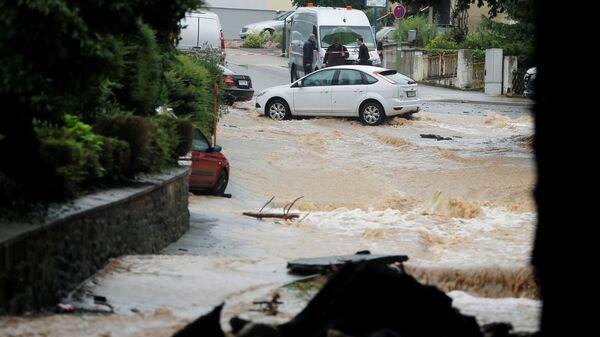 Затопленная улица после проливных дождей в Хагене, Германия  - Sputnik Česká republika