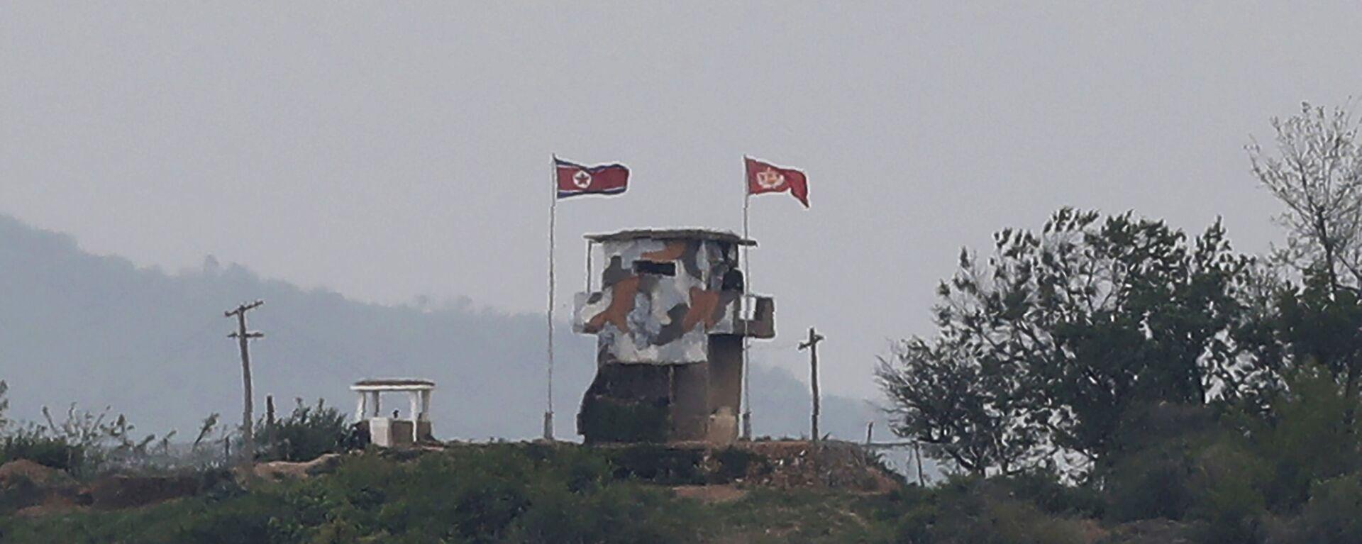 Vlajka KLDR na hranici s Jižní Koreou - Sputnik Česká republika, 1920, 27.07.2021