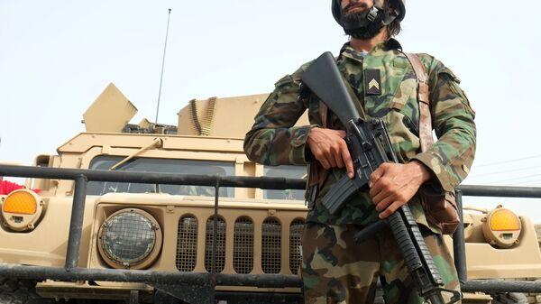 Афганские силы обороны и безопасности на линии соприкосновения с талибами в 7-ом районе города Кандагар - Sputnik Česká republika