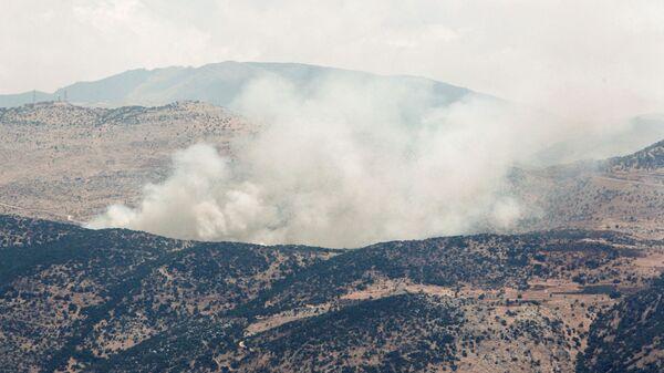 Дым после ракетных ударов недалеко от ливано-израильской границы на юге Ливана - Sputnik Česká republika