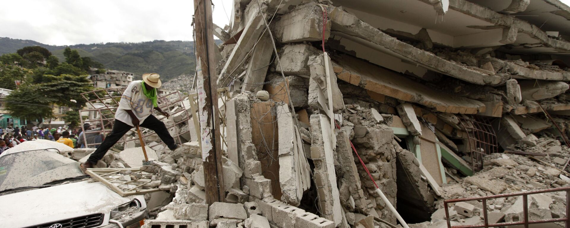 Trosky zničené budovy po zemětřesení, Haiti 2010 - Sputnik Česká republika, 1920, 14.08.2021