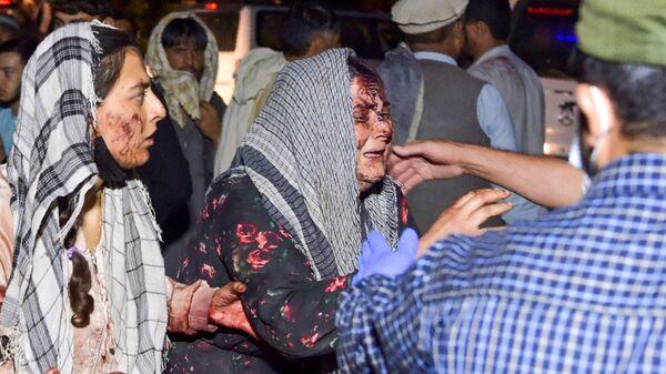 Женщины, раненые в результате двух мощных взрывов, произошедших в Кабуле - Sputnik Česká republika