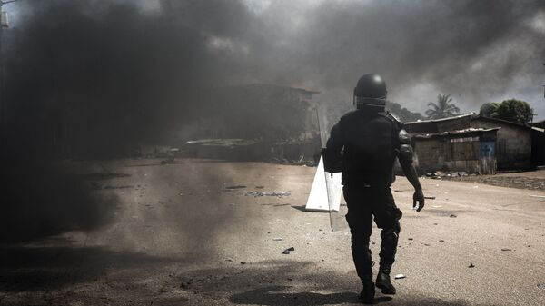 Полиция во время протестов в столице Гвинеи Конакри - Sputnik Česká republika