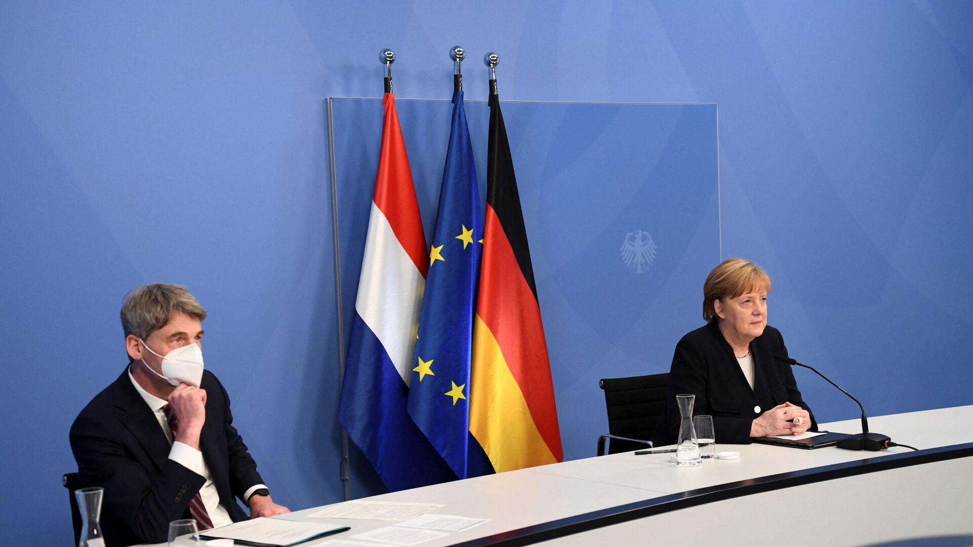 Jan Hecker a Angela Merkelová - Sputnik Česká republika, 1920, 06.09.2021