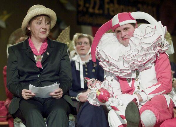 Angela Merkelová na karnevalu v Německu - Sputnik Česká republika