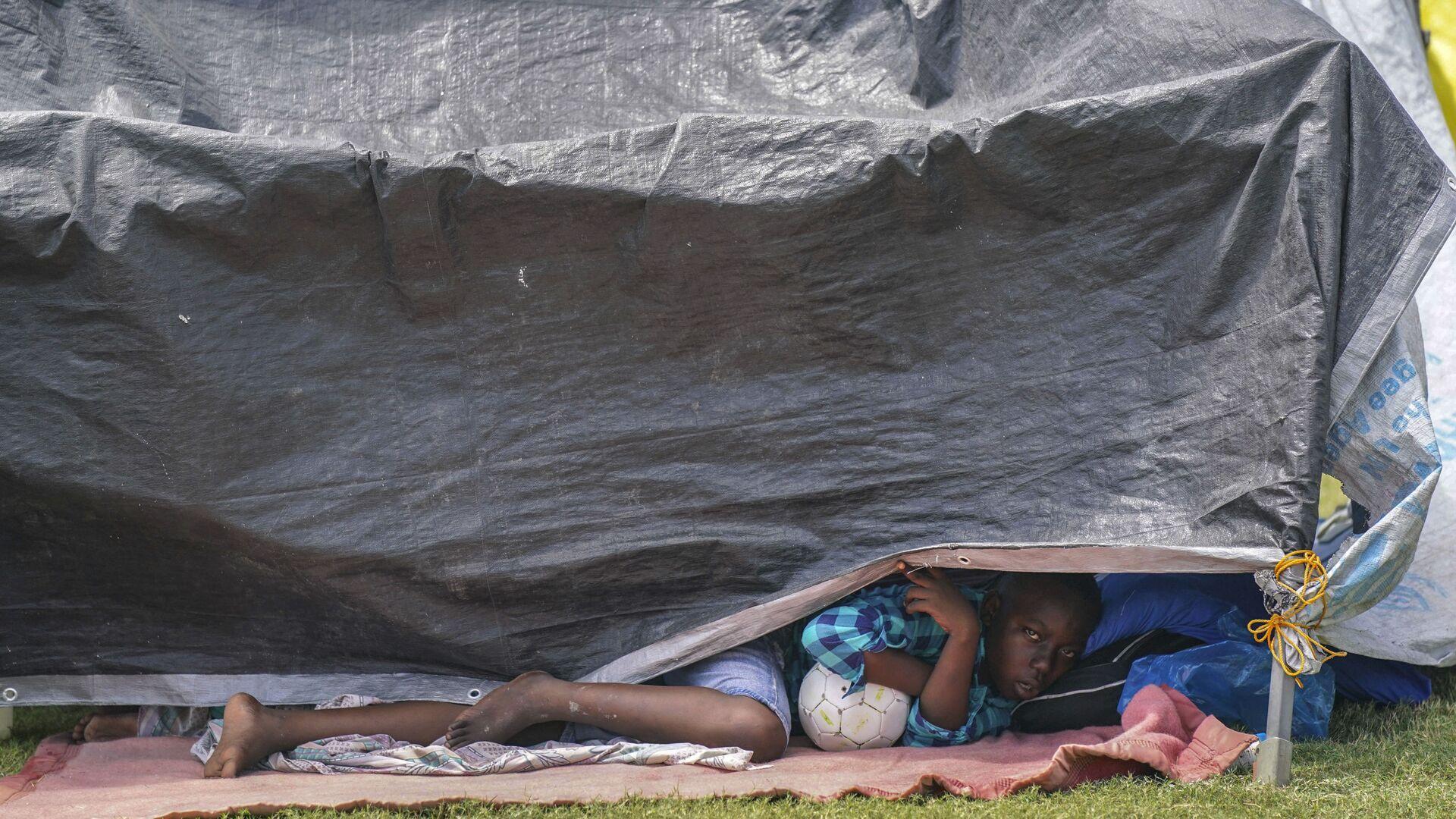 Stan v uprchlickém táboře po zemětřesení na Haiti. Ilustrační foto - Sputnik Česká republika, 1920, 17.09.2021