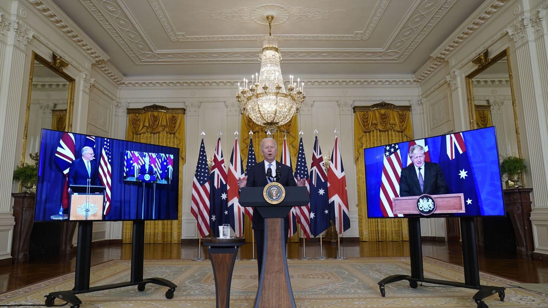 Americký prezident Joe Biden, britský premiér Boris Johnson a australský premiér Scott Morrison oznámili vytvoření nového partnerství AUKUS  - Sputnik Česká republika, 1920, 24.09.2021