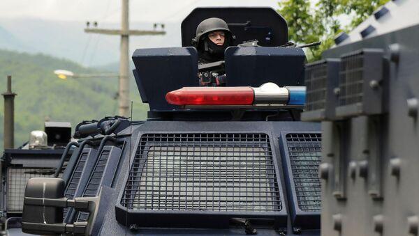 Kosovští policisté u obce Zubin Potok - Sputnik Česká republika