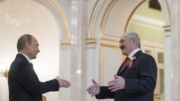 Ruský prezident Vladimir Putin a běloruský prezident Alexandr Lukašenko - Sputnik Česká republika