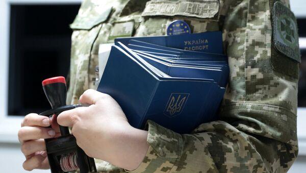 Ukrajinské pasy. llustrační foto - Sputnik Česká republika