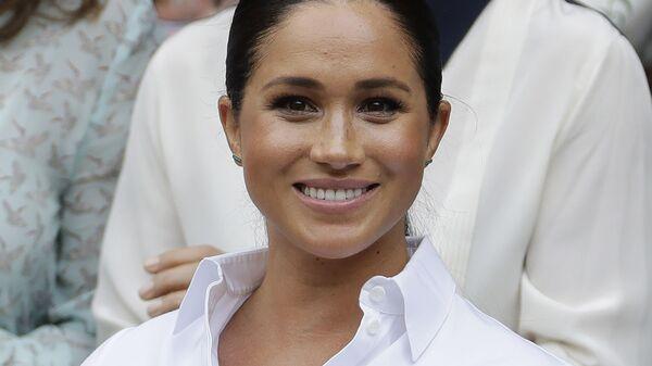 Vévodkyně ze Sussexu, manželka prince Harryho a bývalá herečka Meghan Markleová  - Sputnik Česká republika