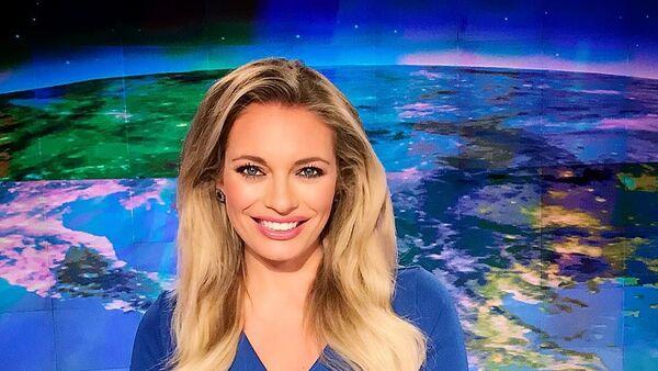 Телеведушая Lucie Borhyová на работе - Sputnik Česká republika