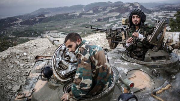 Tankisté vládních syrských vojsk v provincii Latákie. Ilustrační foto - Sputnik Česká republika