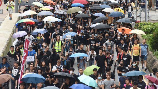 Protestující v Hongkongu - Sputnik Česká republika