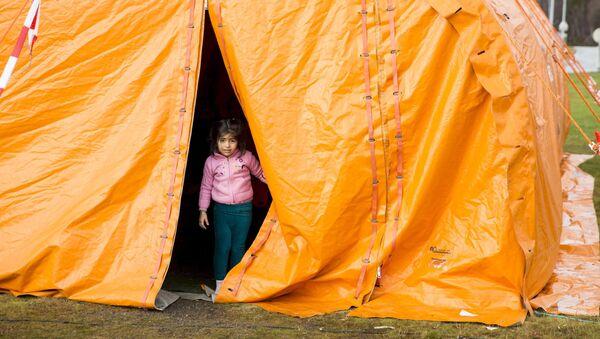 Dívka v uprchlickém táboře v Norsku - Sputnik Česká republika