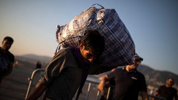 Migrant původem z Afghánistánu - Sputnik Česká republika