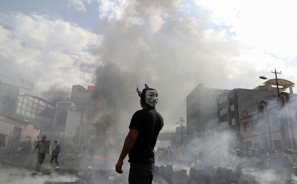 Protestant na mítinku v Ekvádoru. - Sputnik Česká republika