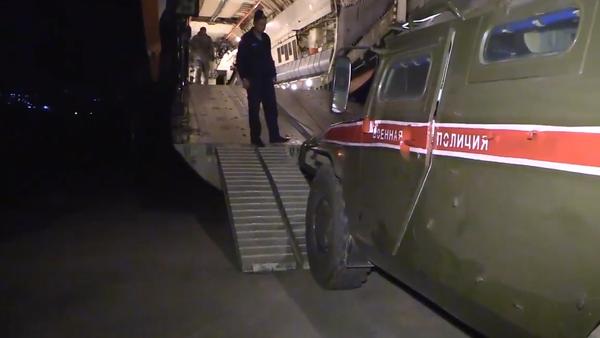 Desítky ruských obrněných vozidel Tigr a Tajfun na syrské letecké základně Hmímím - Sputnik Česká republika