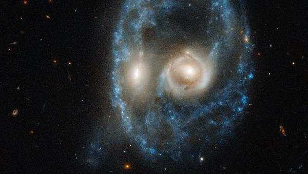 Foto kolize dvou galaxií, kterou vyfotil Hubble. - Sputnik Česká republika