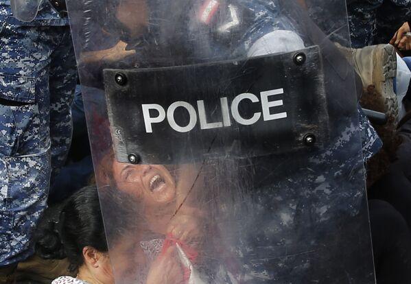 Zadržení demonstrantů v Bejrútu (26. 10. 2019) - Sputnik Česká republika