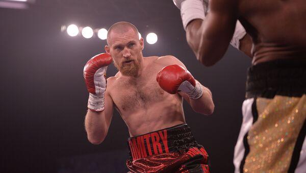 Boxer Dmitrij Kudrjašov během zápasu v Jekatěrinburgu - Sputnik Česká republika