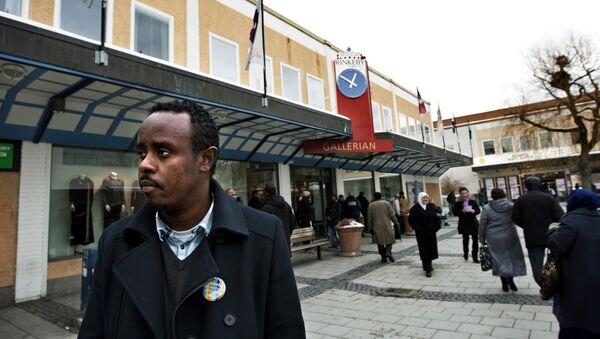 Rinkeby, předměstí Stockholmu většinou obývané převážně migranty - Sputnik Česká republika