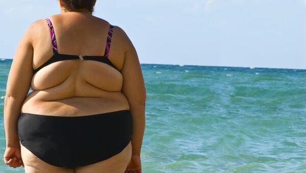 Žena na pláži  - Sputnik Česká republika