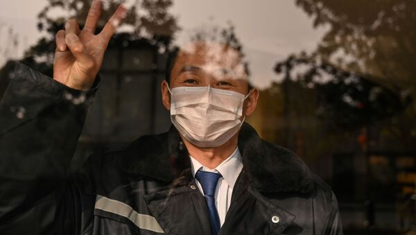 Muž v hotelu. Wu-chan, Čína - Sputnik Česká republika