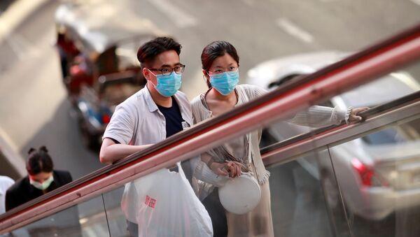 Obyvatelé Bangkoku v ochranných maskách - Sputnik Česká republika