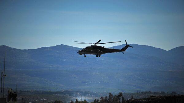 Bitevní vrtulník Mi-24 v Sýrii. Ilustrační foto - Sputnik Česká republika