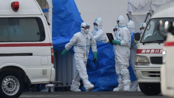 Japonští lékaři v ochranných oblecích - Sputnik Česká republika