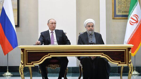 Prezident Ruska Vladimir Putin a prezident Íránu Hasan Rúhání - Sputnik Česká republika