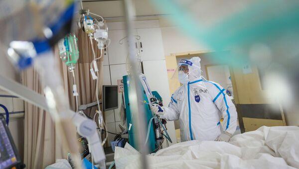 Zdravotnický pracovník v nemocnici v Číně - Sputnik Česká republika