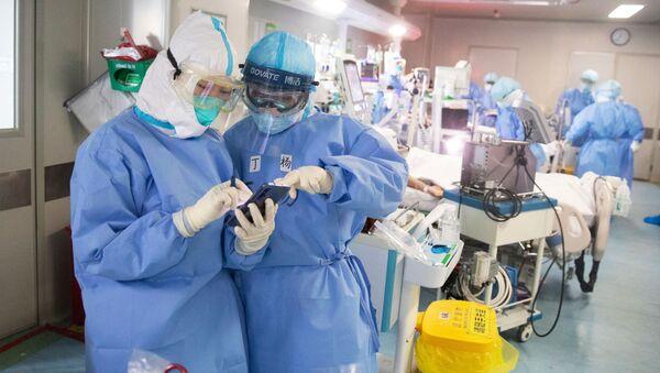 Lékaři v Číně. Ilustrační foto - Sputnik Česká republika