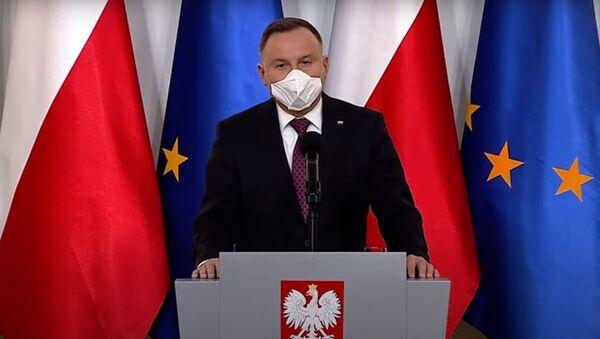 Polský prezident Andrzej Duda v ochranné roušce - Sputnik Česká republika