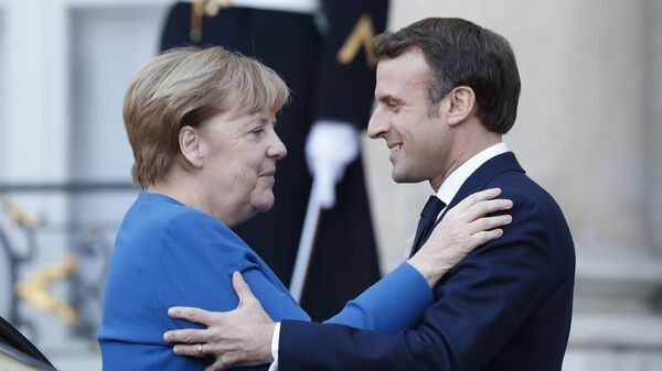 Německá kancléřka Angela Merkelová a francouzský prezident Emmanuel Macron v Paříži - Sputnik Česká republika